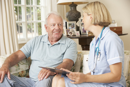 sheltered: Retired Senior Man Having Health Check With Nurse At Home