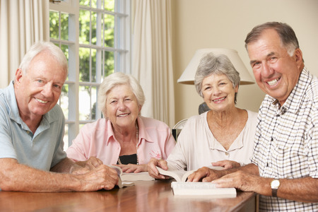 read the book: Group Of Senior Couples Attending Book Reading Group