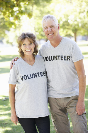 Senior Couple Working As Part Of Volunteer Group