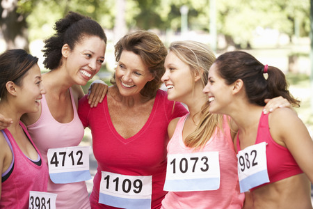 fundraising: Group Of Female Athletes Competing In Charity Marathon Race Stock Photo