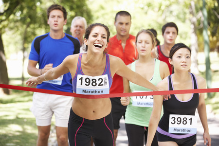 Female Athlete Winning Marathon Race Stock Photo