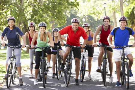 bicycle helmet: Group Of Cyclists On Cycle Ride Through Park