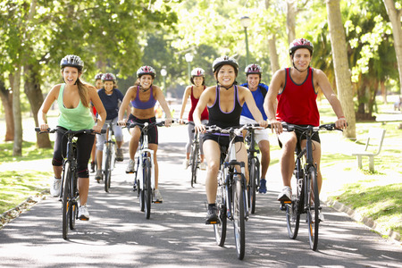medium group: Group Of Cyclists On Cycle Ride Through Park