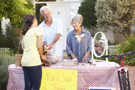 yard sale: Senior Couple Holding Yard Sale