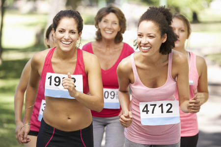 Group Of Female Athletes Competing In Charity Marathon Race Stock Photo - 42247748