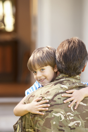 returning: Soldier Returning Home And Greeted By Son