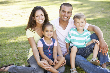 4 5 year old: Family Relaxing In Summer Park
