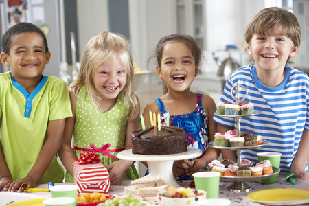 5 6 years: Group Of Children Standing By Table Laid With Birthday Party Food