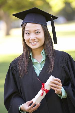 attending: Female Student Attending Graduation Ceremony Stock Photo