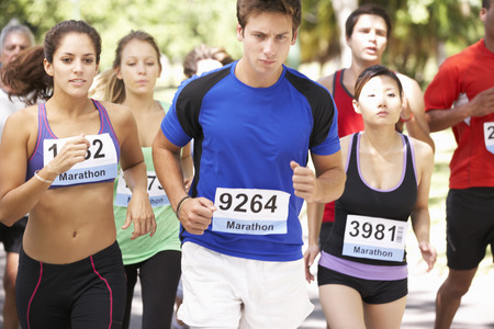outdoor fitness: Group Of Marathon Runners At Start Of Race Stock Photo