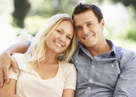 couple relaxing: Couple Relaxing On Sofa At Home