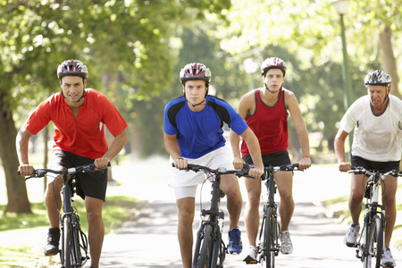 Group Of Men On Cycle Ride Through Park