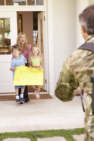 returning: Soldier Returning Home And Greeted By Family