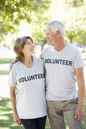 compassionate: Senior Couple Working As Part Of Volunteer Group