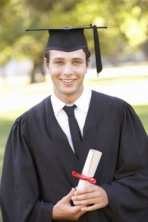 Male Student Attending Graduation Ceremony Stock Photo