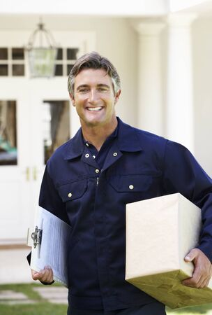 courier: Portrait Of Courier Delivering Package Stock Photo