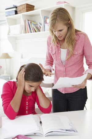 telling: Mother Telling Daughter Off For Bad School Report