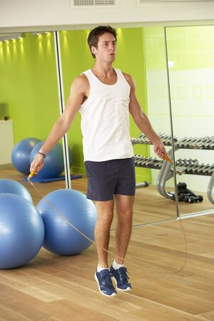 skipping rope: Man Exercising With Skipping Rope In Gym