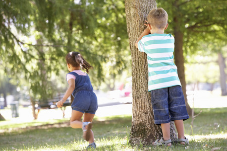 hide and seek: Two Children Playing Hide And Seek In Park