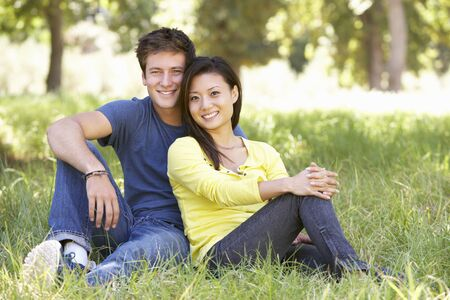 relaxed woman: Young Couple Relaxing In Countryside