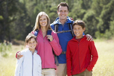 11 year old: Portrait Of Family On Hike In Beautiful Countryside