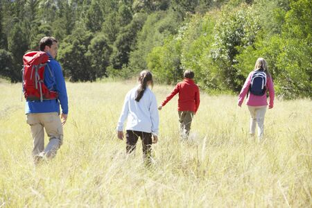 11 year old: Family On Hike In Beautiful Countryside