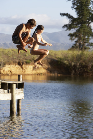 swimshorts: Two Children Jumping From Jetty Into Lake