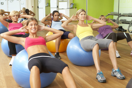 Women Taking Part In Gym Fitness Class. Stock Photo