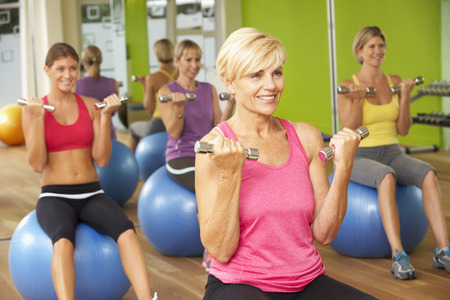 middle aged women: Women Taking Part In Gym Fitness Class