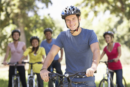 sallow: Group Of Young Friends On Cycle Ride In Countryside Stock Photo