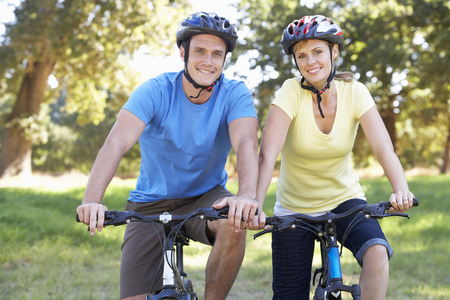 cycle ride: Couple On Cycle Ride In Countryside Stock Photo