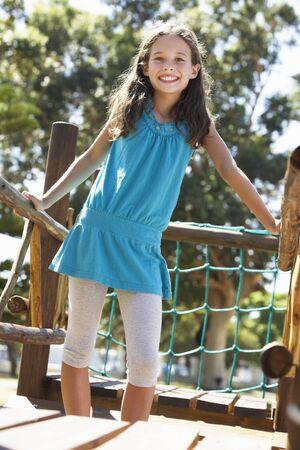 11 year old girl: Young Girl Having Fun On Climbing Frame Stock Photo