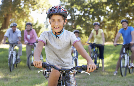 cycle ride: Three Generation Family On Cycle Ride In Countryside Stock Photo
