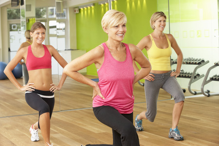 middle age: Women Taking Part In Gym Fitness Class