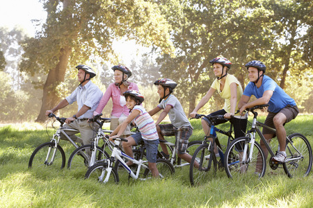 three generation: Three Generation Family On Cycle Ride In Countryside Stock Photo