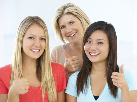 thumbs up group: Group Of Happy And Positive Businesswomen In Casual Dress Making Thumbs Up Gesture Stock Photo