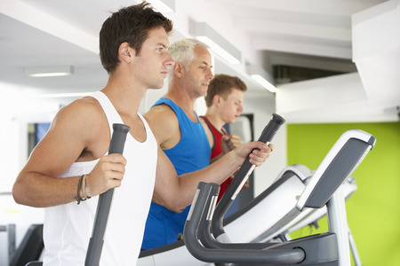keep fit: Group Of People Using Different Gym Equipment
