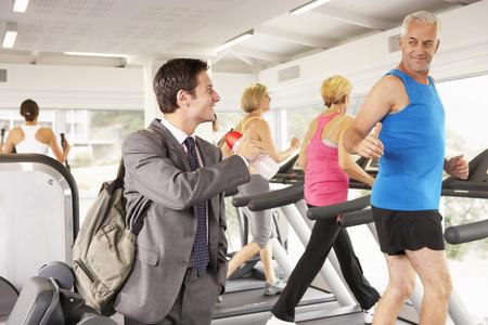 after work: Businessman Arriving At Gym After Work