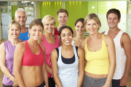 Portrait Of Group Of Gym Members In Fitness Class