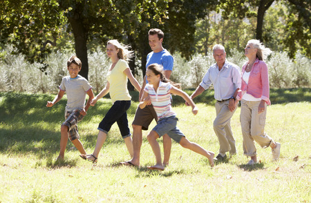 three generation: Three Generation Family Walking In Countryside