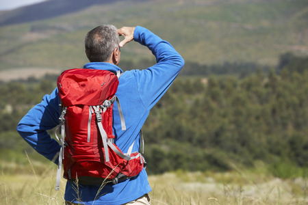 man field: Senior Man On Hike Through Beautiful Countryside