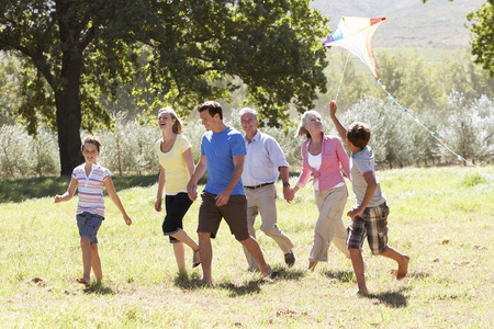 three generation: Three Generation Family Walking In Countryside