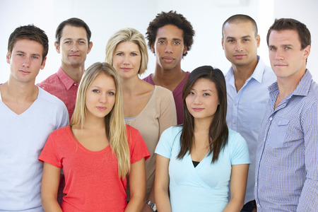 workers group: Group Of Young Business People In Casual Dress Stock Photo