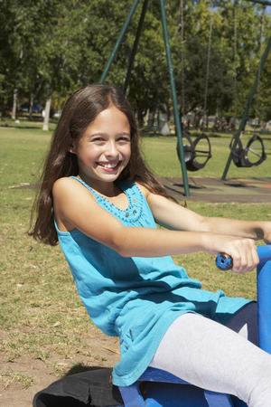 11: Young Girl Having Fun On Seesaw Stock Photo