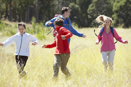 10 year old: Family On Hike In Beautiful Countryside