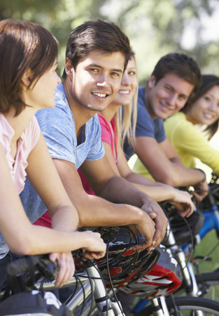 cycle ride: Group Of Young Friends On Cycle Ride In Countryside Stock Photo