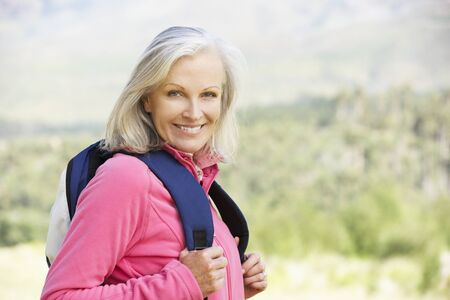 Portrait Of Senior Woman On Hike Stock Photo