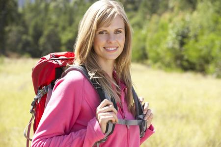 woman hiking: Woman On Hike In Beautiful Countryside