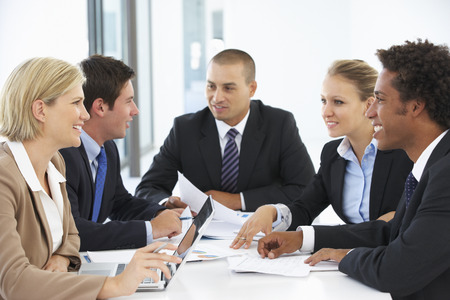 mixed age range: Group Of Business People Having Meeting In Office