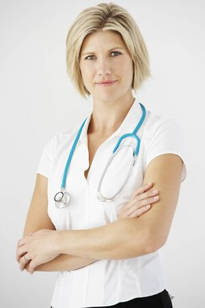 one person: Studio Portrait Of Female Doctor Against White Background